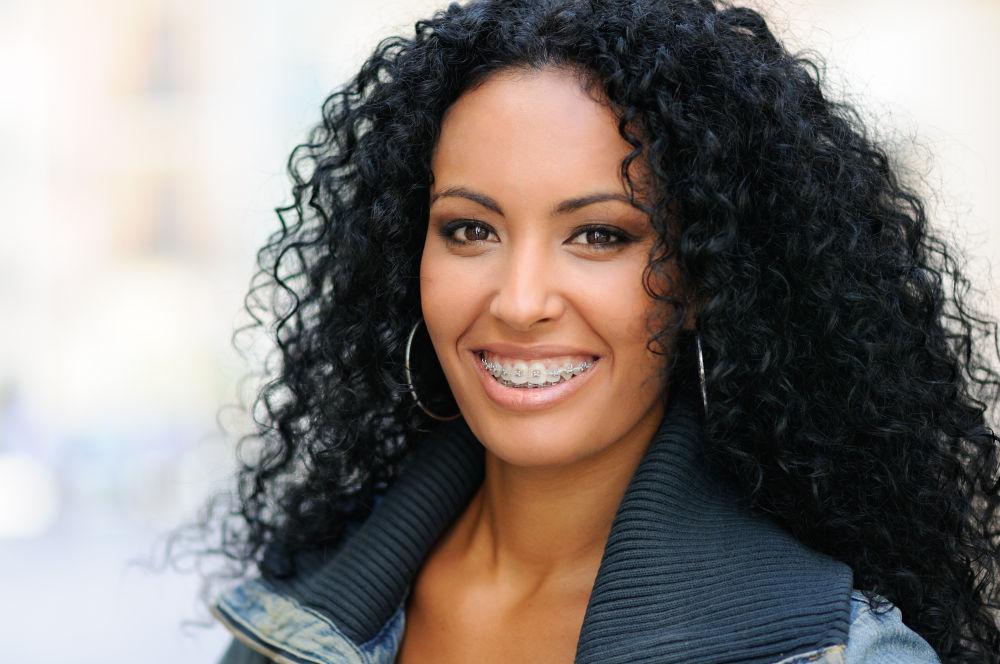 Braces Manassas | Woman with braces smiling.