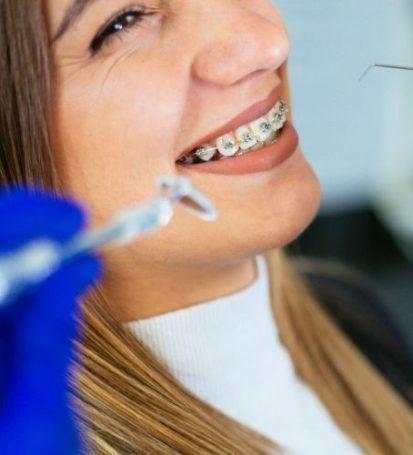 orthodontics |woman with braces smiling